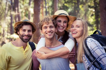Group of friends standing together in forest