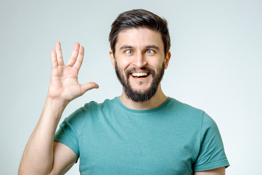 Man making Vulcan salute isolated