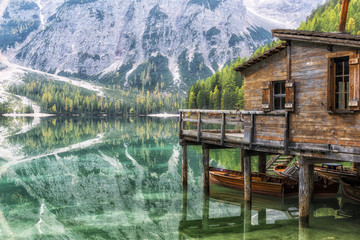 Italy, South Tirol, Hut on stilts over the lake Braies, Natural Park Fanes-Sennes-Braies.