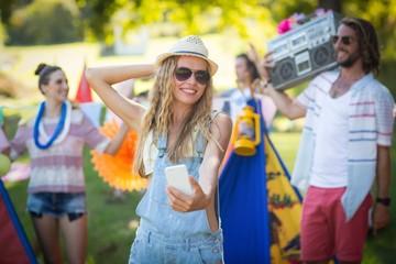 Woman taking selfie at campsite