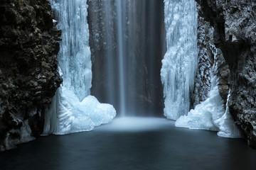 Waterfall from Smeraldo lake in winter, Non Valley, Trentino Alto Adige, Italy.