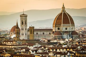 Florence, Tuscany, Italy. cityscape and Cathedral and Brunelleschi Dome, Giotto Tower. Sunset, lights on.