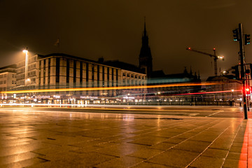 Cars leaving light trails on a street in Hamburg at night
