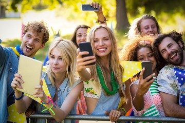 Friends clicking pictures from their mobile phones