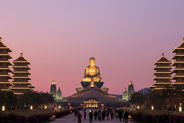Kaohsiung, Taiwan. Sunset at Fo Guang Shan buddist temple of Kaohsiung with many tourists walking by.