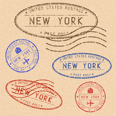 Collection of NEW YORK postal stamps partially faded on beige paper background