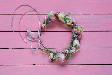 Flower wreath hairpin with flowers isolated on pink background