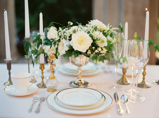 Wedding table setting with flowers and candles, close up
