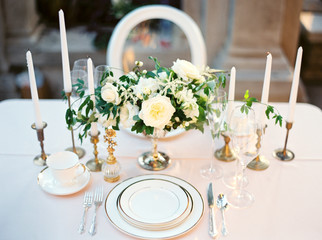 Wedding table setting with flowers and candles