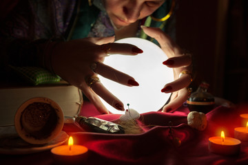 Old gypsy soothsayer looking at crystal ball