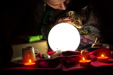 Fortuneteller with crystal ball and cat