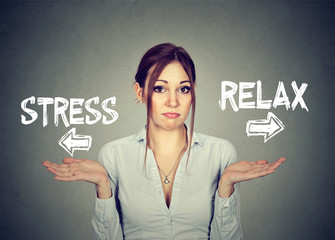Stress or relax. Confused woman shrugging shoulders doesn't know