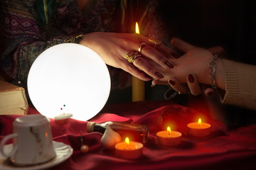 Fortune teller woman doing palm reading