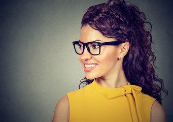 Portrait of a smiling woman in glasses looking to the side