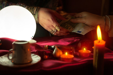 Fortune teller woman receive money for fortune telling