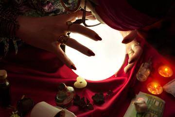 Gypsy woman using crystal ball for predicting of future