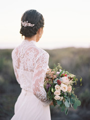 Bridal hairstyle, dress and bouquet