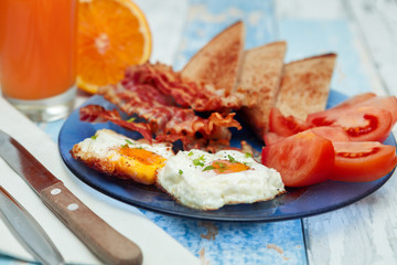 Delicious breakfast with fried eggs on plate