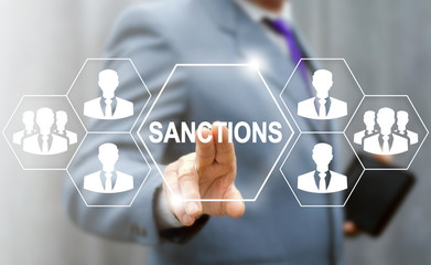 Sanctions Business concept. Man touched sanction icon on virtual screen on background of network people, businessman. Political and economic measures of deterrence countries. Embargo government Wall mural