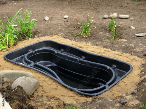 Testing of an installed preformed plastic pond insert for Garden pond insert