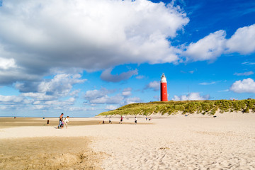 Lighthouse and beach of De Cocksdorp on Texel island, Netherlands