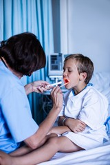 Female doctor examining patient mouth