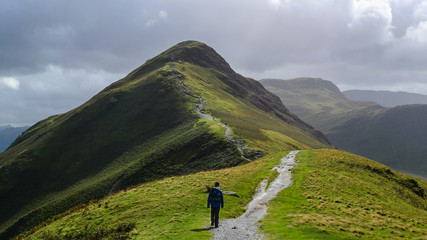 Hiking trail in the mountain landscape of Catbells hill top in Lake District, England