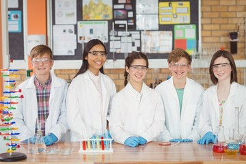 Portrait of students doing a chemical experiment
