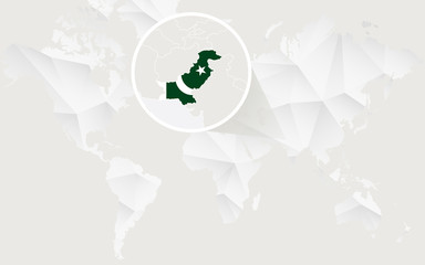 Pakistan map with flag in contour on white polygonal World Map.