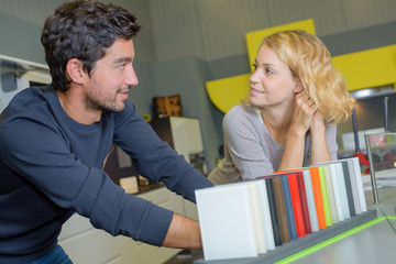 Couple looking at color samples