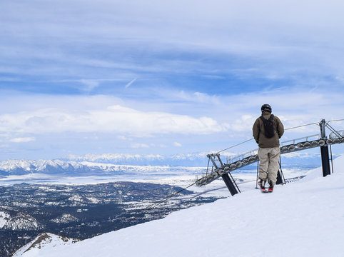 Skier Pausing Before Dropping Over the Cornice at Mammoth Mountain Ski Area