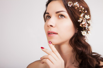 stylish gorgeous brown haired woman with blooming branch