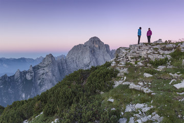 Europe, Italy, Veneto. Hikers on the First Pala di San Lucano summit  looking the sunrise. Agordo Dolomites, Belluno, Italy
