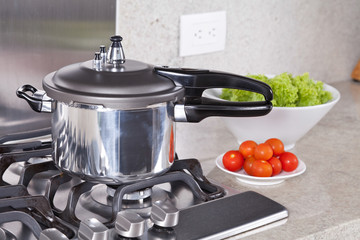 double valve pressure cooker, in a Kitchen setting