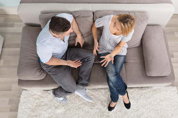 Couple Having Discussion At Home
