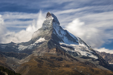 Matterhorn surrounded by clouds.  Zermatt Canton of Valais Pennine Alps Switzerland Europe