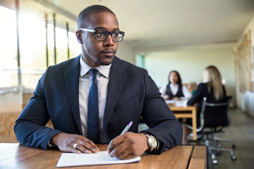 Company workshop focus on handsome male african american businessman sitting at table meeting