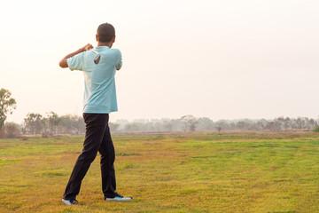 Golfer finishing his driver swing