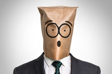 Businessman with a bag on the head - with surprised face