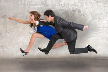 Small businesswoman and businessman running away