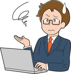 パソコンで仕事をするスーツの男性