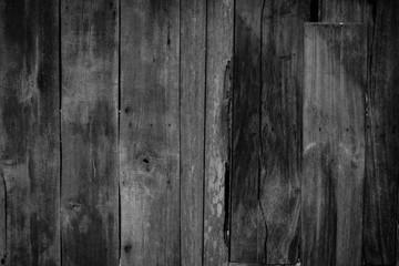 Black wood textured background.