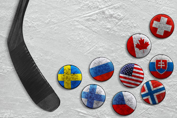 Hockey pucks and putter on ice