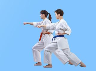 Sportswomen in karategi are beating punch arm