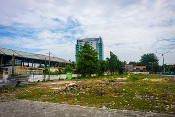 dirty empty park with trash and cloudy sky as background photo taken in Tanah Abang Jakarta Indonesia