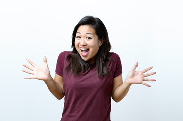 Excited laughing young Chinese woman