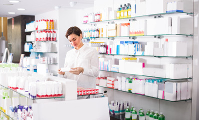 Woman is browsing rows of body care products