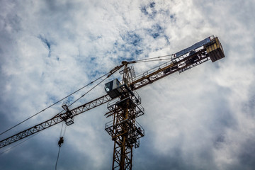 big crane for building construction with cloudy sky as background photo taken in Jakarta Indonesia