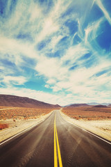 Vintage toned desert road in Death Valley.