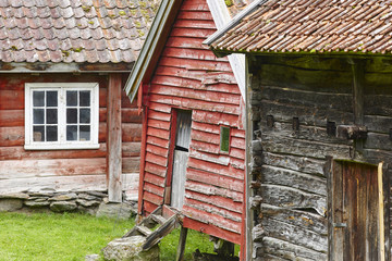 Traditional norwegian wooden red colored cabin houses facades. Otternes